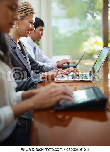 business man and women typing on pc during meeting - csp8289128