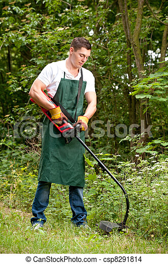 Gardener with lawn trimmer - csp8291814