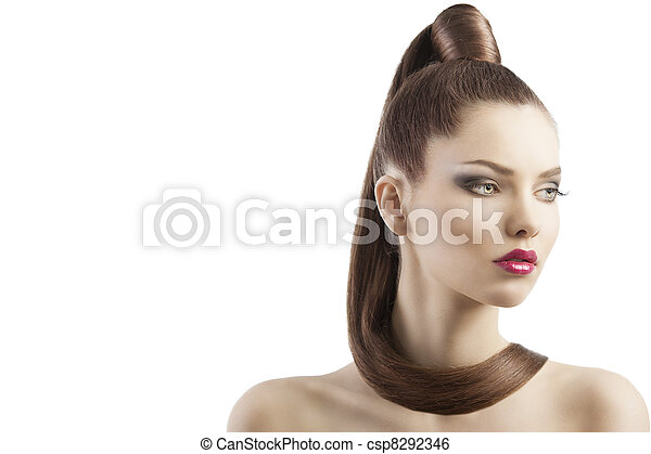 very attractive young brunette with long hair and tail and creative hair style looking luxory and proud, she is turned of three quarters and looks down at left and has a lock of hair around her neck - csp8292346