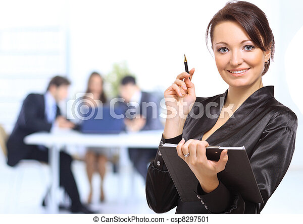 Portrait of successful businesswoman and business team at office meeting - csp8297501