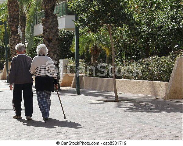 Couple of seniors walking in a big - csp8301719