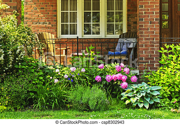 Banco de fotos de frente casa jardim frente de lar for Casa con jardin al frente