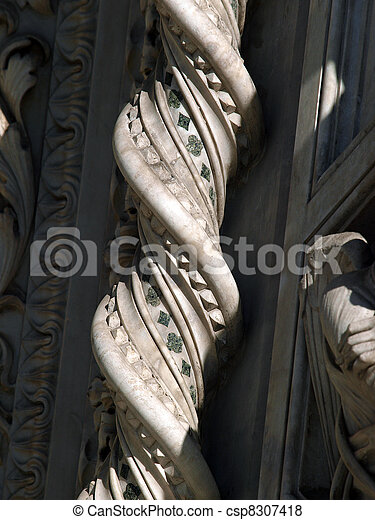 Florence - elaborate decorations of the portal on the Duomo facade - csp8307418