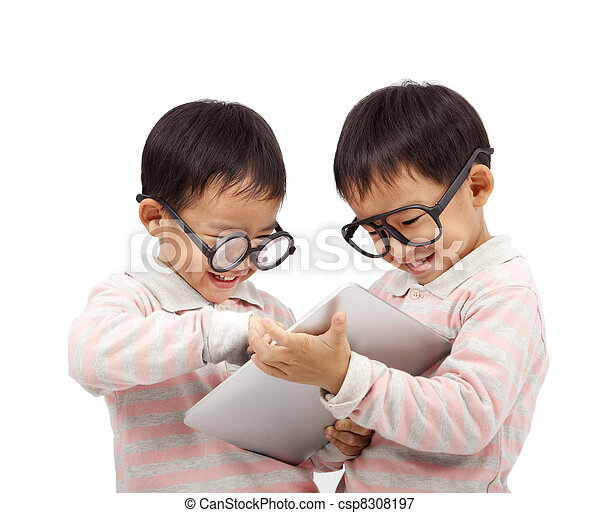 two happy kids using touch pad computer  and isolated on white  - csp8308197