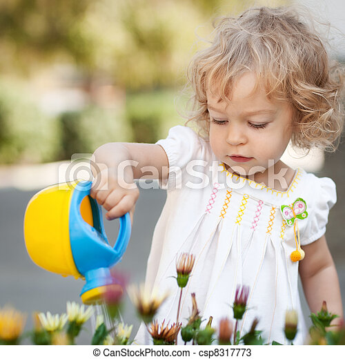 Child in spring garden - csp8317773