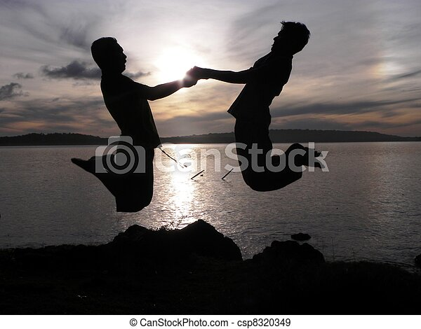 Silhouette Of Boys Jumping