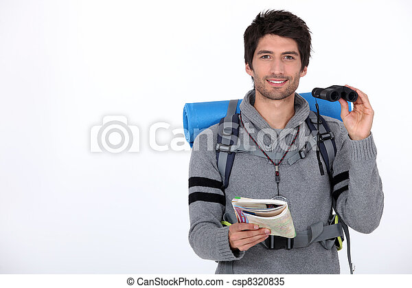 Backpacker with pair of binoculars - csp8320835