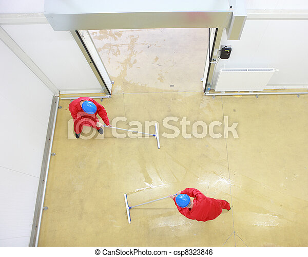 two workers cleaning floor  - csp8323846