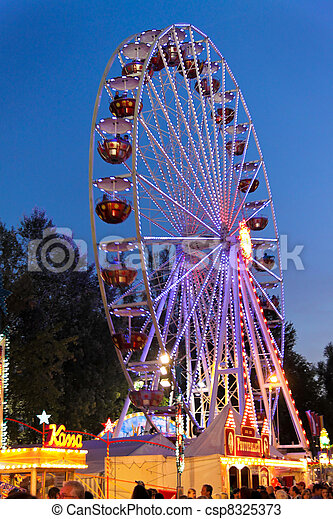 Ferris wheel at a carnival in the evening - csp8325373