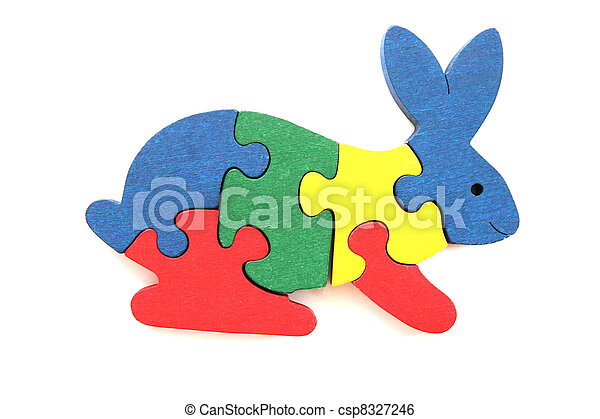 Stock Image of Colorful wooden rabbit puzzle toy on white background ...