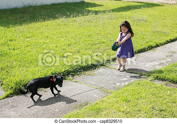 Little girl having trouble with her dog in the park - csp8329510