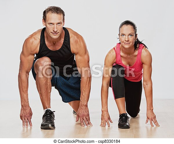Athletic man and woman doing fitness exercise - csp8330184