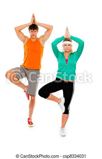 photographies de yoga isol fitness girl blanc v tements de sport homme csp8334031. Black Bedroom Furniture Sets. Home Design Ideas