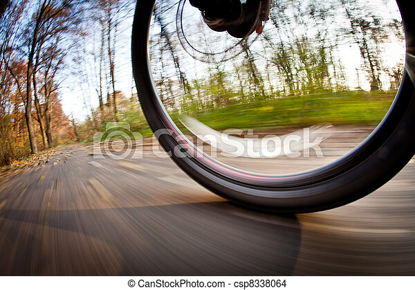 Bicycle riding in a city park on a lovely autumn/fall day - csp8338064
