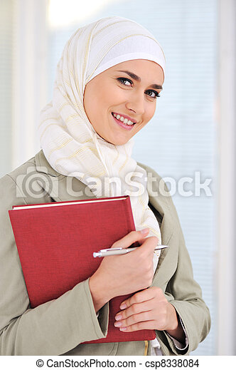 Muslim Caucasian female student with notebook and pen - csp8338084