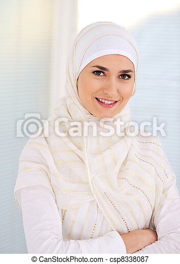 Young beautiful Muslim woman with traditional but fashionable clothes - csp8338087