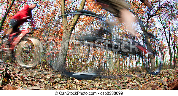 Bicycle riding in a city park on a lovely autumn/fall day - csp8338099
