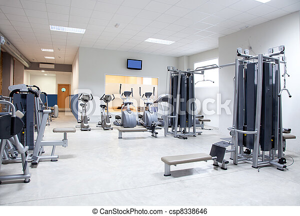 Fitness club gym with sport equipment interior - csp8338646