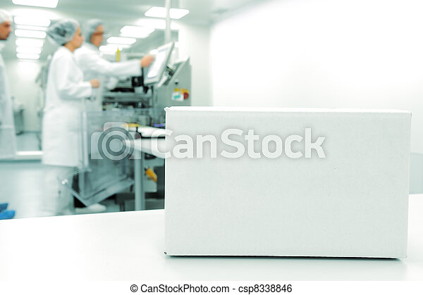 White box at automated production line at modern factory, people working in background - csp8338846