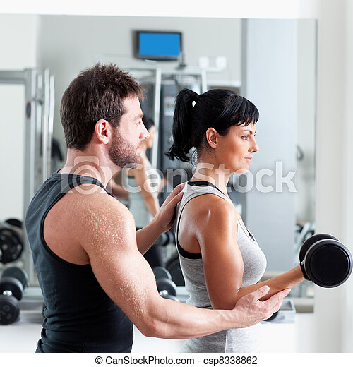 gym woman personal trainer with weight training - csp8338862