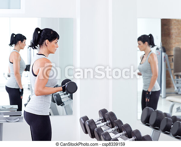 woman with weight training equipment on sport gym - csp8339159