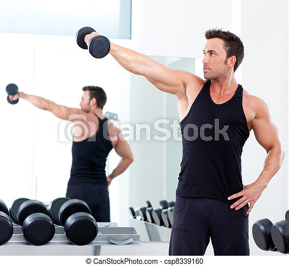 man with weight training equipment on sport gym - csp8339160