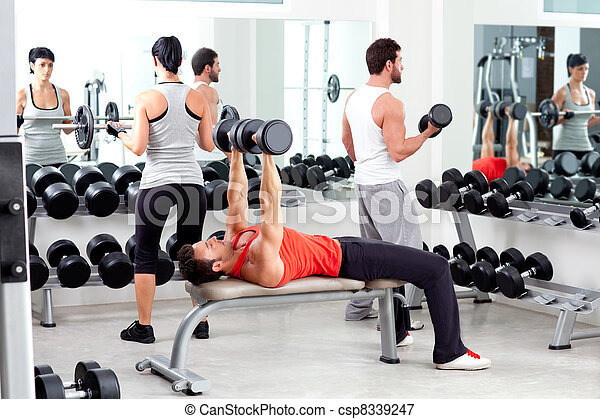 group of people in sport fitness gym weight training - csp8339247