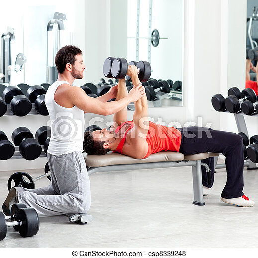 gym personal trainer man with weight training - csp8339248
