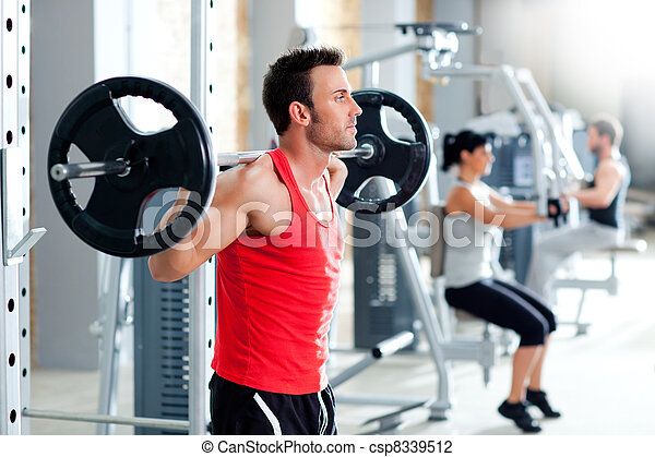 man with dumbbell weight training equipment  gym - csp8339512