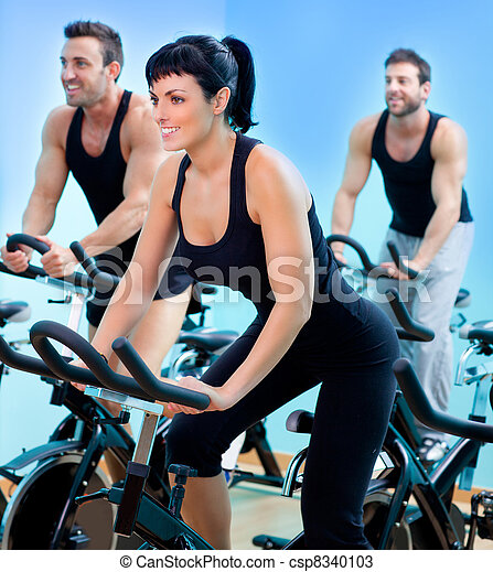 Stationary spinning bicycles fitness girl in a gym - csp8340103