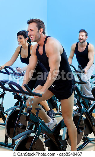 Stationary spinning bicycles fitness man in a gym sport club - csp8340467