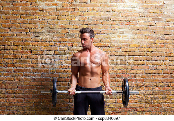 muscle shaped body man with weights on brick wall - csp8340697