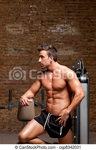 fitness shaped muscle man posing on gym - csp8342031