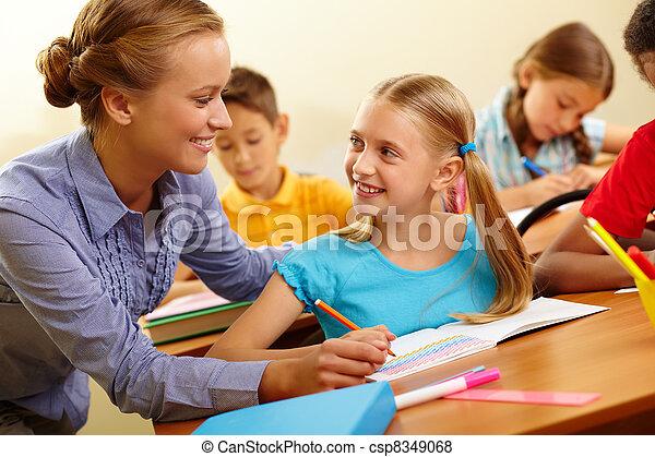 Pupil and teacher - csp8349068