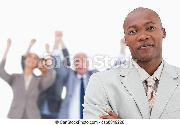 Tradesman with cheering team behind him - csp8349226