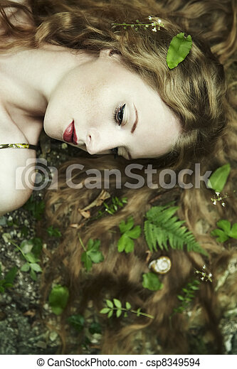 Fashion portrait of young sensual woman in garden - csp8349594