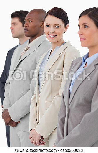 Smiling businesswoman standing between her associates - csp8350038