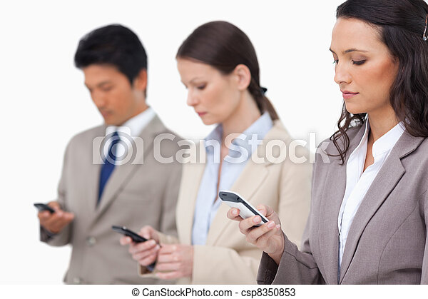 Business team looking at their cellphones - csp8350853