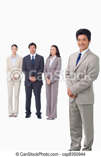 Businessman standing with his associates behind him - csp8350944