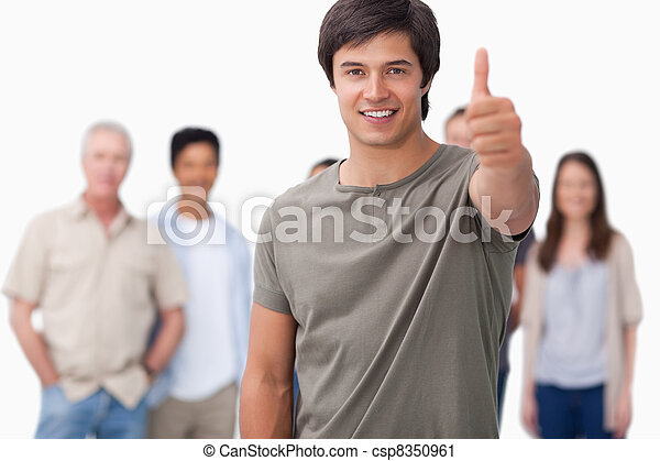 Smiling man with friends behind him giving approval - csp8350961