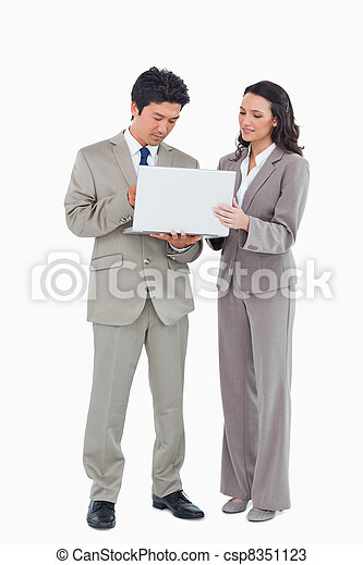 Young sales team using laptop together - csp8351123