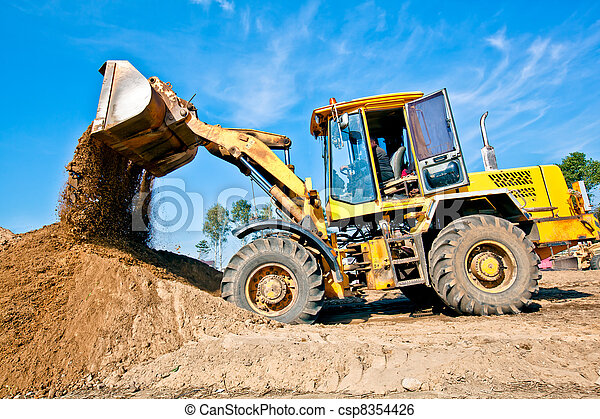 Wheel loader unloading soil - csp8354426