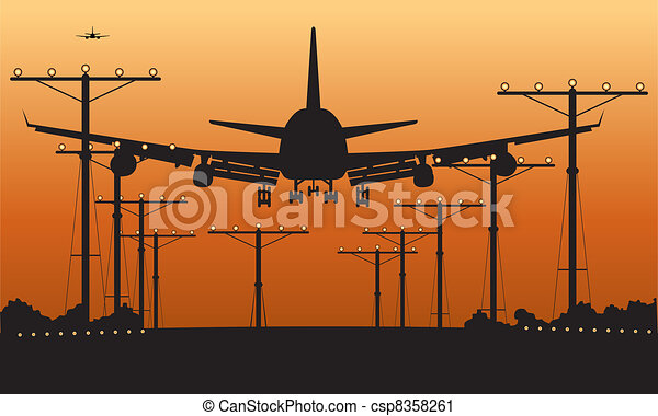 airliner landing at sunset  - csp8358261