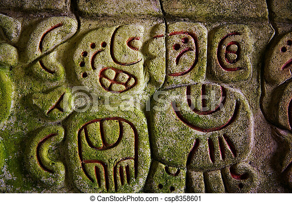Ancient Mayan hieroglyphics in stone, from the ruins at Caracol, Belize - csp8358601