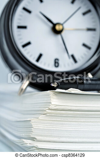 Conceptual shot of office work in relation with time efficiency. - csp8364129