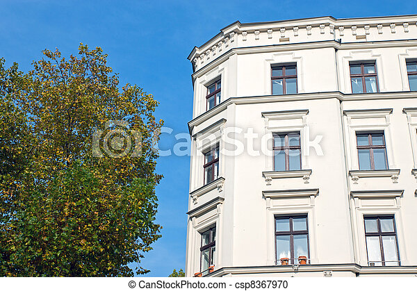 Green tree and white town house - csp8367970
