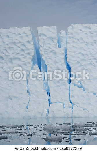 Iceberg with large cracks. - csp8372279