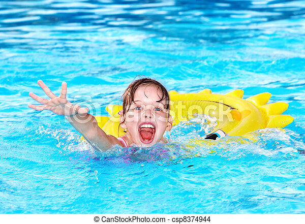 Kid  on inflatable ring in swimming pool. - csp8374944