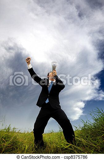 man in the black suit and holding megaphone shouting to the storm - csp8375786