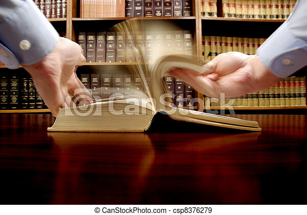 Hand on Law Book - csp8376279